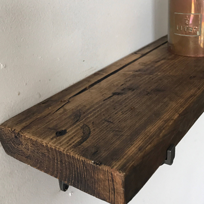 Reclaimed wood shelf and cast iron brackets